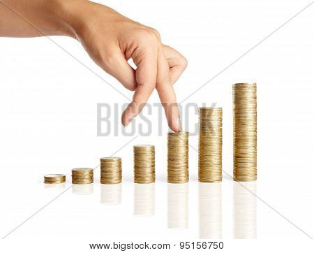 Hand And Stacks Of Coins