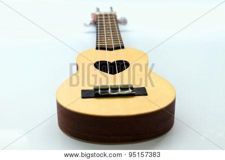 Close up of ukulele on white background