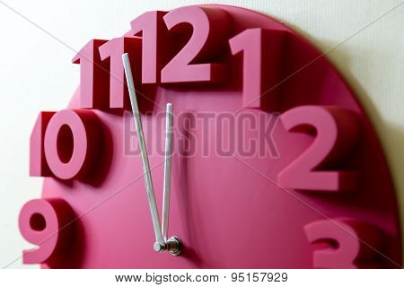 Red Clock With Five To Midnight