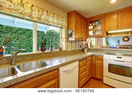 Classic Kitchen With Hardwood Floor And Bar.