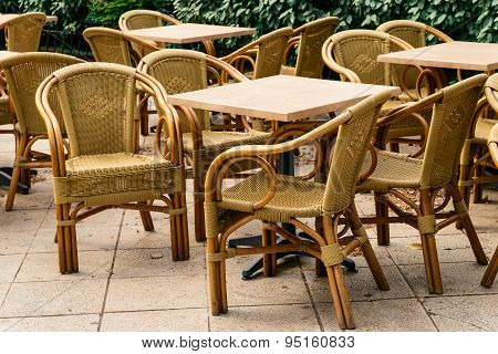 Summer cafe with rattan chairs