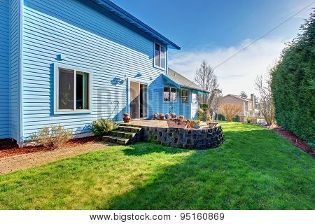 Large Back Yard With Lots Of Grass.