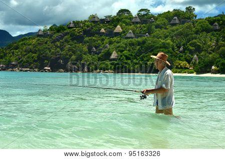 Elderly man fishing in the sea