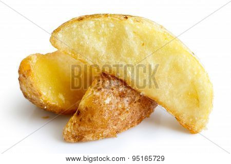 Detail Of Fried Potato Wedges Isolated On White.