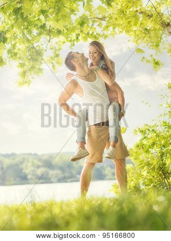 Couple in love on the lake hug