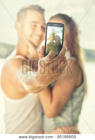 Couple in love on the lake close-up selfie