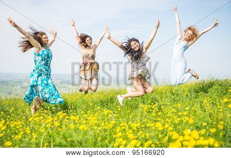 Four Girls Jumping In The Nature. Concept About Airiness And Carefree.