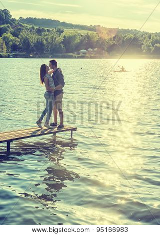 Couple embrace on the pier