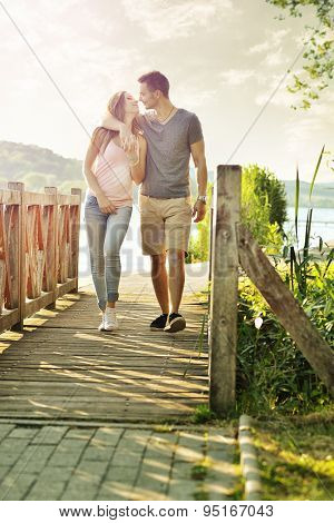 Couple walking on the bridge