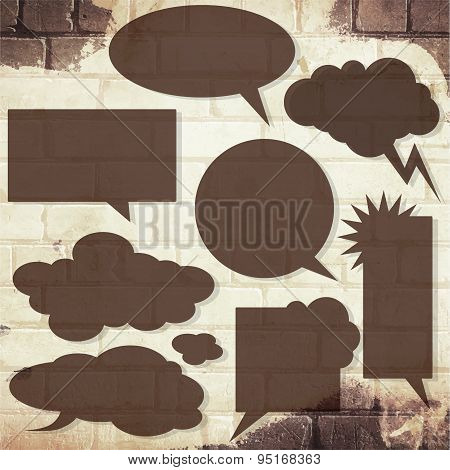 Vector speech bubbles with shadow like clouds on brick wall
