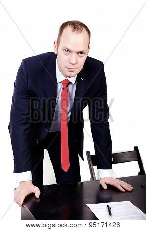 Director with a red tie leaned on the table