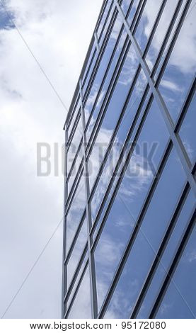 New Glass Building With Reflecting Clouds