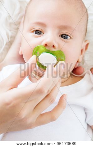 Cute Newborn Baby With A Pacifier