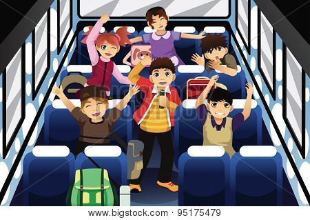 School Children Singing And Dancing Inside The School Bus