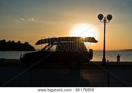 Fisherman and his car at sunset at Toroni beach