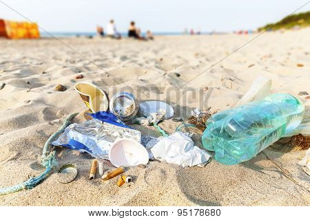 Garbage On A Beach Left By Tourist At Sunset.