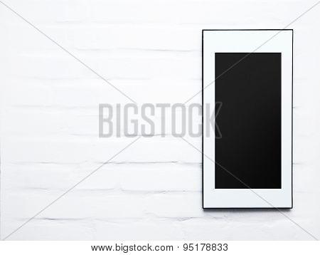 Black frame Poster On The White Brick Wall. Mock up. Scandinavian design
