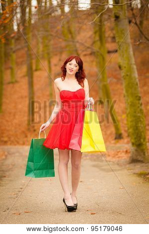Autumn Shopper Woman With Sale Bags Outdoor In Park