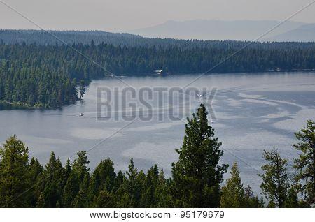 People Enjoying Summer Lake In The Mountains