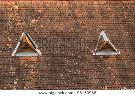 Old house top with traditional roof and little windows