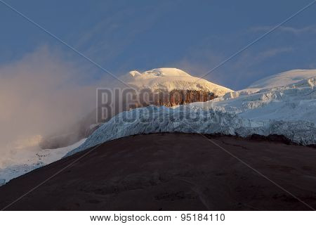 Summit And Yanasacha Rock Wall In The Cotopaxi Volcano At Dusk