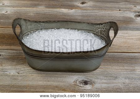 Old Metal Bucket Filled With Crushed Ice On Rustic Wooden Boards