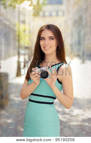Happy Elegant Woman with Compact Digital Camera