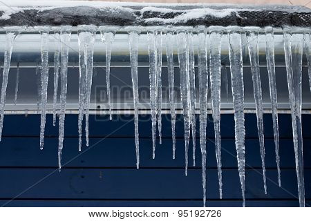 Icicles On The Roof. Winter Season