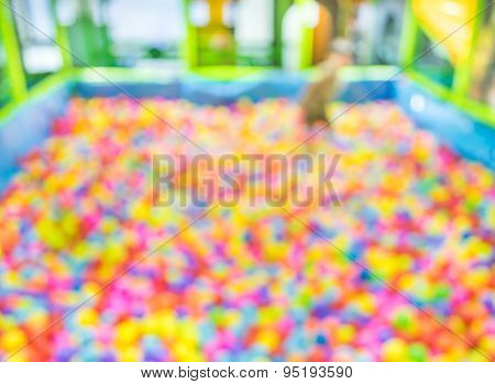 Blur Image Of Colorful Plastic Balls On Children's Playground .