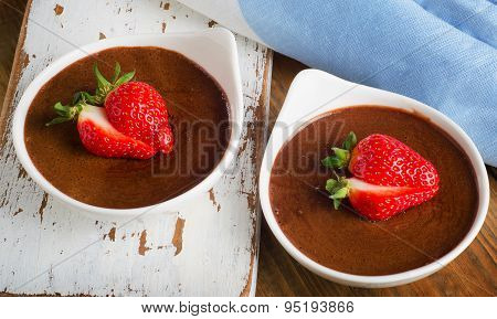 Homemade Chocolate Mousse With Fresh Berries On  A Wooden Table.