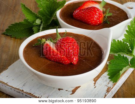 Homemade Chocolate Mousse With Fresh Berries On  Rustic    Wooden Table.