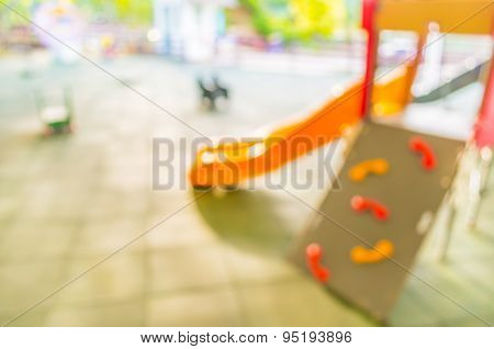 Defocused And Blur Image Of Children's Playground At Public Park For Background Usage