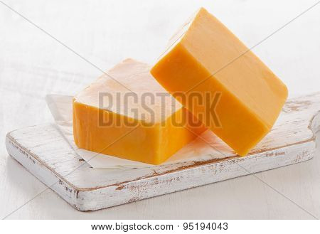 Cheddar Cheese On A Cutting Board