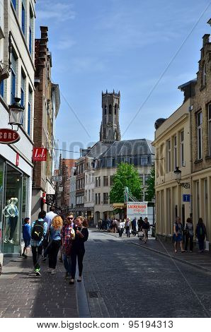 Bruges, Belgium - May 11, 2015: Tourists Visit Steenstraat Shopping Street In Bruges, Belgium.