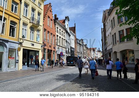 Bruges, Belgium - May 11, 2015: Tourists Visit Steenstraat Shopping Street In Bruges