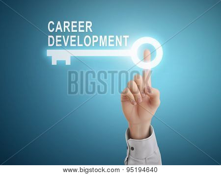 Male Hand Pressing Career Development Key Button