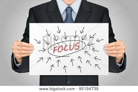 Businessman Holding Focus Word Poster