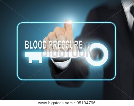 Male Hand Pressing Blood Pressure Key Button