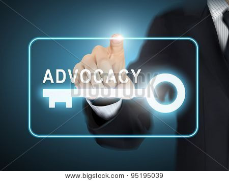 Male Hand Pressing Advocacy Key Button