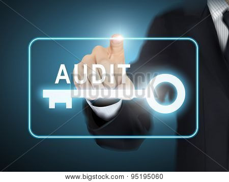 Male Hand Pressing Audit Key Button