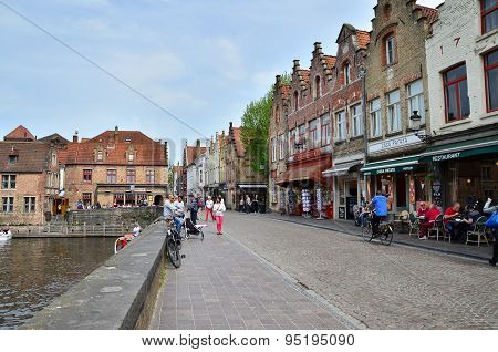 Bruges, Belgium - May 11, 2015: Tourist Visit Rozenhoedkaai (the Quai Of The Rosary) In Bruges