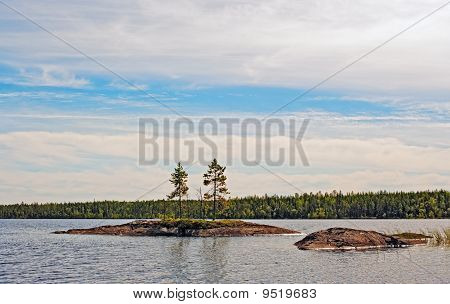 Small Stone Islands On Lake