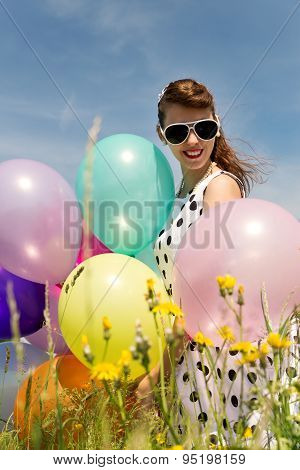 Attractive Rockabilly Girl With Balloons In The Nature