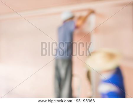Blur Image Of People  Fixing House Wall.