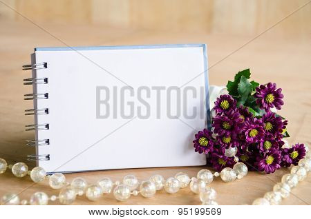 Blank Diary And Violet Flower.