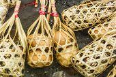 image of quail  - Quail eggs in round bamboo basket boil on hot spring - JPG