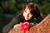 Thoughtful Young Woman With Rose.