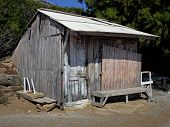 picture of beach hut  - Weathered  wooden beach hut  in full sun - JPG