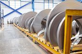 stock photo of ferrous metal  - Rolls of metal sheet waiting for assembly in factory - JPG