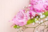 foto of gladiolus  - branch of pink gladiolus on wooden table - JPG
